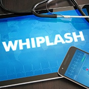 phone, tablet that reads 'whiplash' and stethoscope