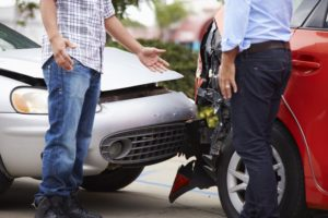 two men in front of car accident