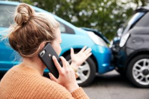 woman talking on the phone after a car accident