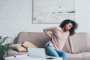 woman with back pain in Dallas