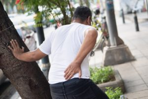 man with back pain after a car accident or lumbar strain
